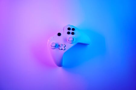 Gamepad in violet snd blue neon colors. Gamer concept.