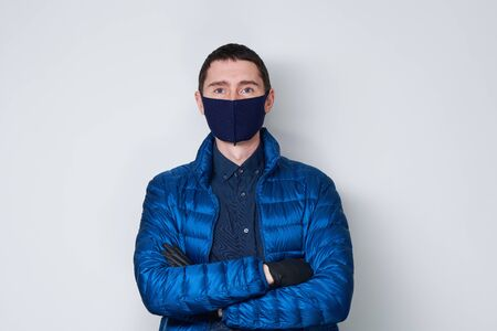 Man wearing a protective mask to prevent the spread of Coronavirus.