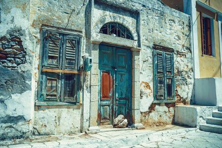 Old building ruins from white stone on the Greek island of Symi, Dodecanese, Greece 版權商用圖片