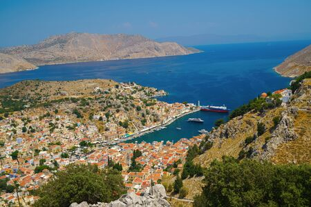 Panoramic view of the picturesque village on the Greek island of Symi, Dodecanese, Greece