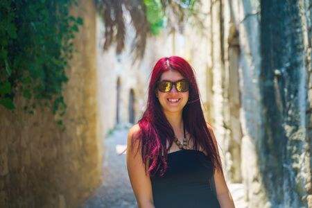 Happy woman traveler is walking and exploring Greek island of Rhodes, Dodecanese, Greece Stock Photo