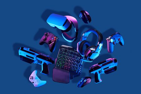 Virtual reality gogles, gamepads and blaster game controllers, games keyboard, mouse and headset. Concept of virtual reality, games, entertainment and communication. Stock Photo