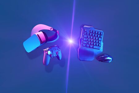Virtual reality headset and gamepad vs games keyboard and mouse. Stock Photo