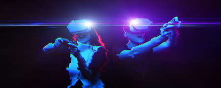 Couple with virtual reality headset are playing game. Image with glitch effect. Standard-Bild