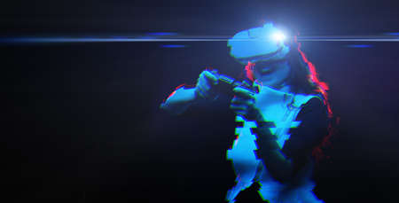 Woman with virtual reality headset is playing game. Image with glitch effect. Concept of virtual reality, games, entertainment and communication. Standard-Bild