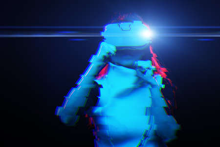 Woman with virtual reality headset is playing game and fighting. Image with glitch effect.