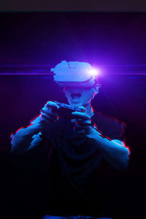 Man with virtual reality headset is playing game. Image with glitch effect. Standard-Bild