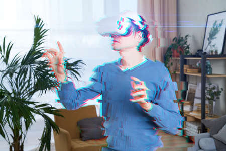 Man is using virtual reality headset. Image with glitch effect. Standard-Bild