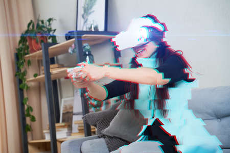 Woman with virtual reality headset is playing game. Image with glitch effect.