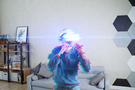 Man with virtual reality headset is playing game and fighting. Concept of virtual reality, games, entertainment and communication. Image with glitch effect.