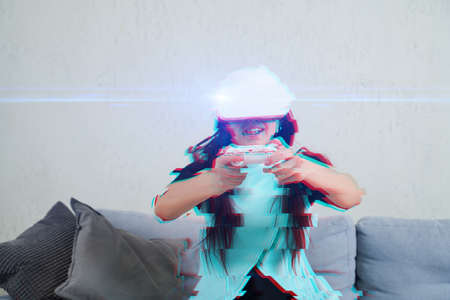 Woman with virtual reality headset is playing game. Image with glitch effect. Concept of virtual reality, games, entertainment and communication. .
