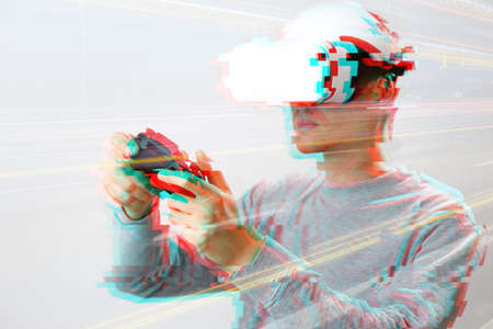 Man with virtual reality headset is playing game. Image with glitch effect. Concept of virtual reality, games, entertainment and communication.