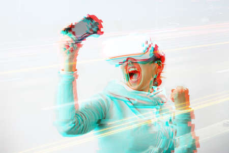 Woman with virtual reality headset is playing game. Image with glitch effect. Concept of virtual reality, games, entertainment and communication. Stockfoto