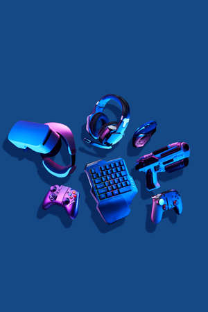 Virtual reality gogles, gamepads and blaster game controllers, games keyboard, mouse and headset.