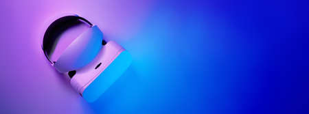 Virtual reality headset in violet and blue neon colors.