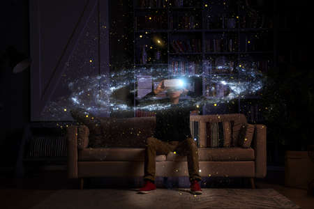 Man uses virtual reality glasses to see the galaxy space. Stockfoto