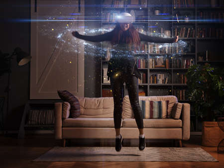 Woman is using virtual reality headset.