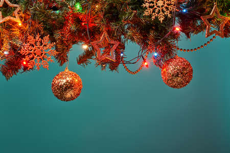Christmas tree branch with stars, balls and garland.