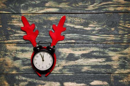 Clock in deer antlers, showing five to twelve