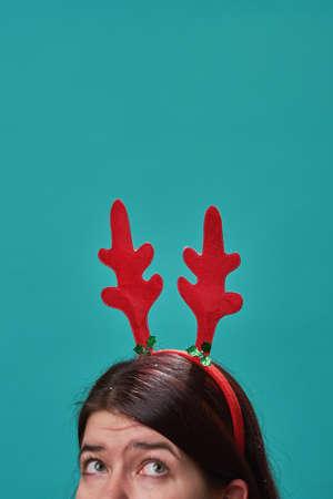 Woman in a headband with deer antlers. Reklamní fotografie