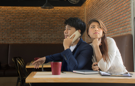 rumour: Young woman trying to listen gossipCurious Girl Listening to Her Boyfriend Talking on The Phone - Girlfriend spying on her loved one eavesdropping private conversation
