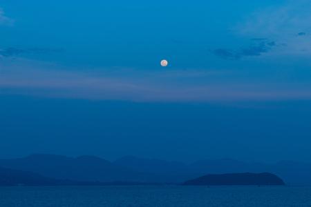 Full moon on the sea at koh  Phangan Stock Photo - 100395049