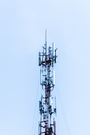 Wave transmission mast, large phone signal with a bright blue sky. 写真素材