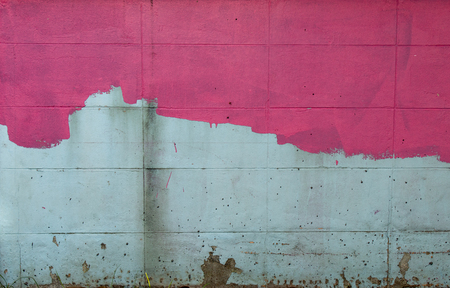 The brick wall is painted pink, not yet started off. 写真素材