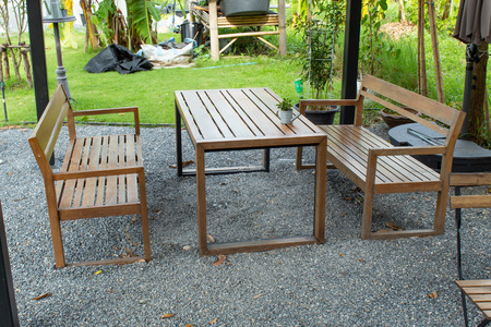 Wooden table and chairs seating In the garden. Stock Photo