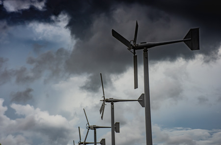 The wind turbine and the dark clouds  at Bang Poo, Samut Prakan. Stock Photo
