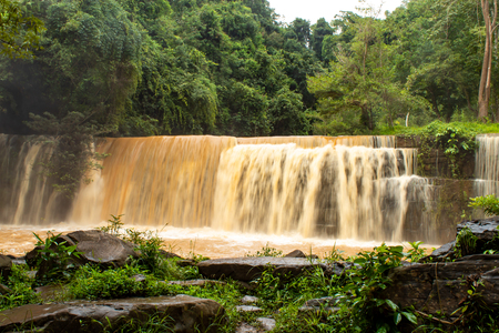 Waterfalls during the rainy season The red soil and water is flowing at Si Dit waterfall , Phetchabun in Thailand. Stock Photo