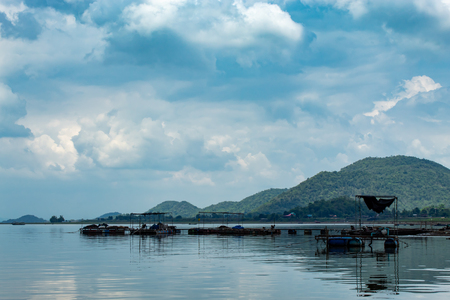Floating raft made of steel and plastic bucket With boat engines in Krasiew dam ,Supanburi Thailand. Stock Photo