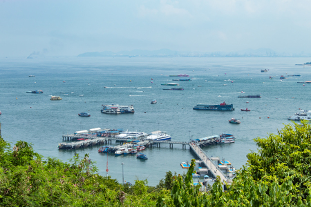 Ferry Port Parking And tourists on the bridge in the sea. Stock Photo