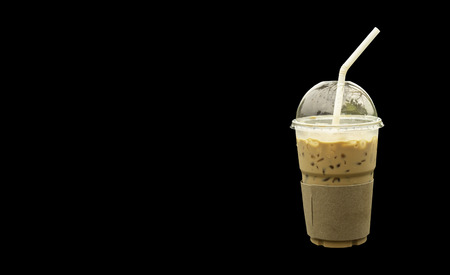Iced coffee in a plastic glass black background. Imagens