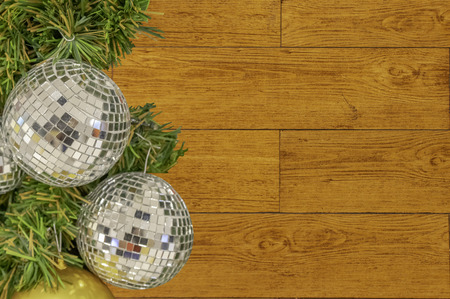Glass ball ornaments on a Christmas tree Background Plywood Floor With Wood Pattern with clipping path. Фото со стока