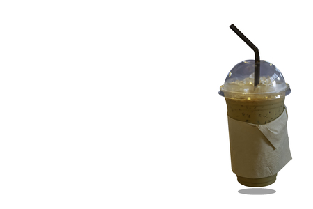 Iced coffee in a plastic glass on a white background with clipping path. Imagens