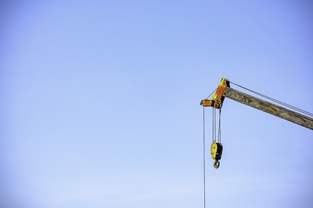 Sling and hoist the crane arm The background sky