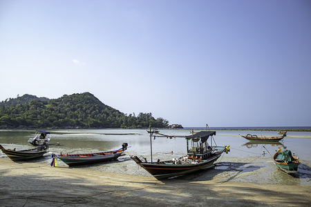 Fishing boats parked on the Beach at Koh Phangan, Surat Thani in Thailand.