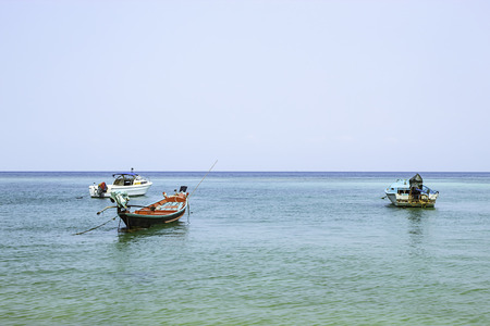 Fishing boats parked on the Beach at Haad salad , koh Phangan, Surat Thani in Thailand. Stock Photo