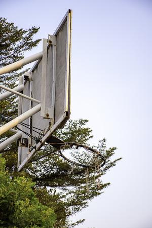 Broken basketball hoop Repair work temporarily background blurry tree and sky.