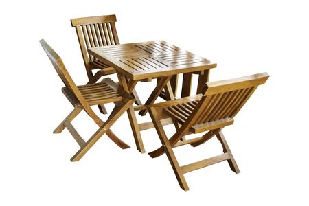 Conjunto de mesa y silla de madera aislado, hermoso vintage sobre un fondo blanco con trazado de recorte. Foto de archivo