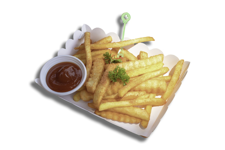 Isolated French fries and tomato sauce in the paper box on a white background with clipping path.