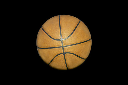 Basketball leather on a black background with clipping path.