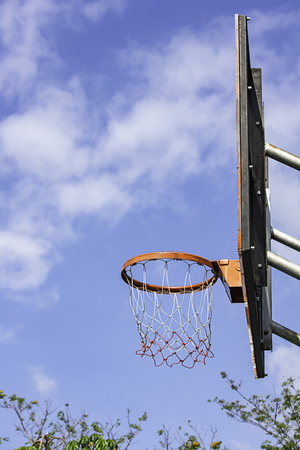 Basketball hoop background blurry tree and the sky. 写真素材