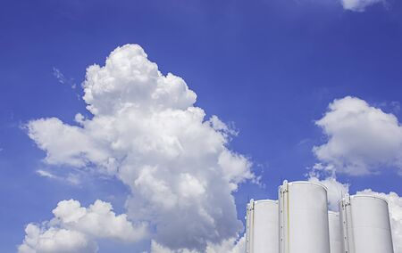 Fuel tanks White and The beauty of the sky with clouds and the sun in summer.