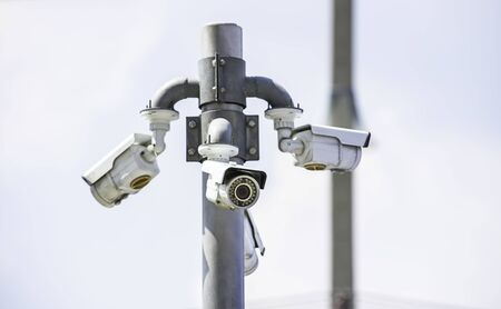 CCTV cameras installed at the corner Background sky. Stock Photo