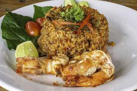 Fried rice with Shrimp on wooden table , spicy food Thai style.