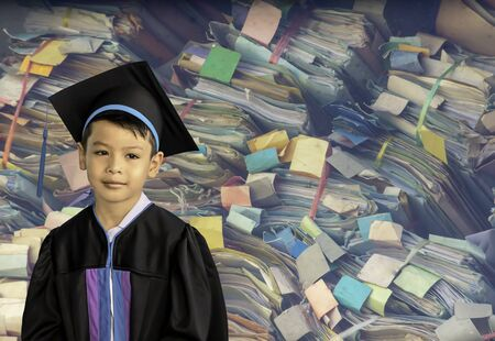 The boy graduated from kindergarten. This study is the first to advance to the next level Background Colorful Dossier made of paper Stackable lot with clipping path.