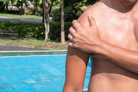 The hand grips the chest that inflammation from a sports injury.