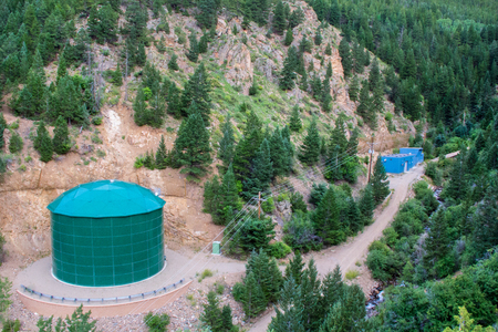 storage tank: Large Green Industrial Water Chemical Storage Tank in Forest of Mountain Hills